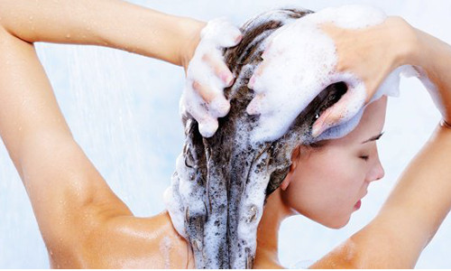 When should you use warm water to wash your hair?